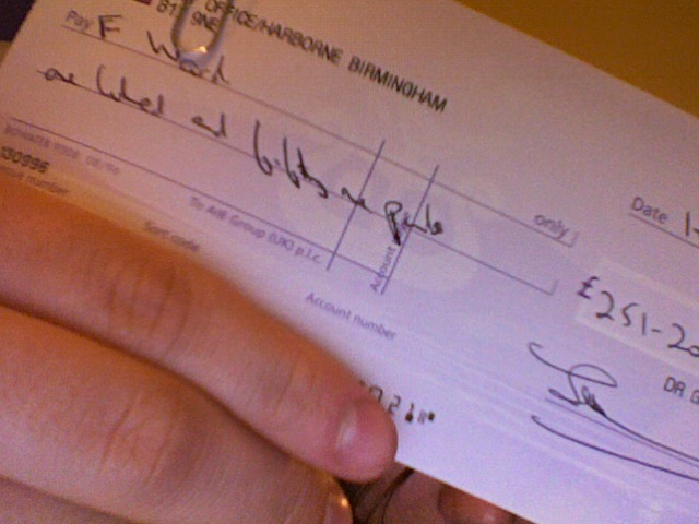 The incorrect cheque (bank details covered)